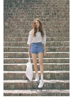 White plaid t-shirt with denim shorts, white socks, and white sneakers