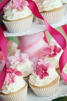 2 tear cake with cascading, matching cupcake.