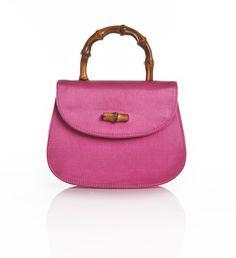Find it here - http://www.vintageheirloom.com/shop/vintage-gucci-pink-satin-minaudiere-handbag-110714/