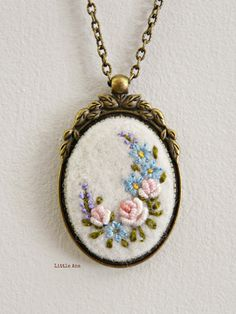Next Post Previous Post Needle felted necklace with hand embroidered flowers, pendant, romantic necklace, shabby chic Nadelgefilzte Halskette mit handgestickten. Embroidery Jewelry, Silk Ribbon Embroidery, Embroidery Hoop Art, Embroidery Stitches, Embroidery Designs, Flower Embroidery, Handmade Necklaces, Handmade Jewelry, Felt Necklace