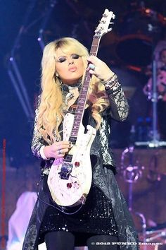 """Orianthi is an Australian musician, singer-songwriter and guitarist. Best known for being Michael Jackson's lead guitarist for his This Is It concert series, and as the lead guitarist in Alice Cooper's live band. Her debut single """"According to You"""" peaked at 2009, Orianthi was named one of the 12 Greatest Female Electric Guitarists by Elle magazine She also won the award as """"Breakthrough Guitarist of the Year"""" 2010 by Guitar International magazine."""