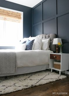 An honest review of all of the rugs throughout our homes, including this shag rug in this navy guest bedroom.