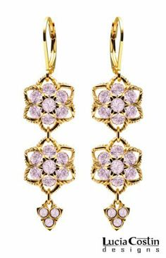 Flower Shaped Dangle Earrings by Lucia Costin with Lilac Swarovski Crystals and Middle Flowers, Adorned with Twisted Lines and 3 Stones Dangle; 24K Yellow Gold Plated over .925 Sterling Silver Lucia Costin. $79.00. Dangle ornaments accented with floral design. Unique jewelry handmade in USA. Dangle earrings beautifully designed by Lucia Costin. Mesmerizing enough to wear on special occasions, but durable enough to be worn daily. Adorned with light purple Swarovski crystals