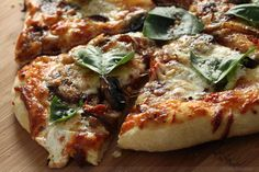 pizza w/ caramelized onions, slow roasted tomatoes, sauteed creminis, italian sausage, fresh mozzarella and basil