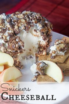 Oooh.. yum.  This Snickers Cheeseball is so fun and yummy.  Perfect Dessert Cheeseball for a party or just for the family!
