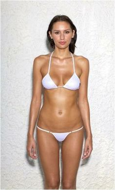 Mini bikini shiny silver with small triangle top. Avaiable colours: shiny golden shiny black and salmon vintage.   http://www.beyouminibikinis.com/en/minibikinis/17-mini-bikini.html