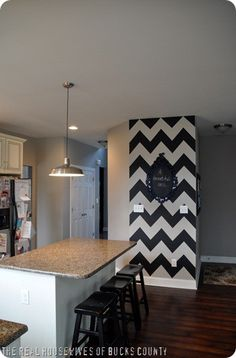 DIY: chevron wall.. I love this for an accent wall.    Do a chevron wall with white and vanduesan blue, just one and rest of the room blue