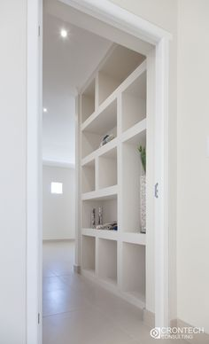 Designer built-in storage and display area perfect for an otherwise dead space.