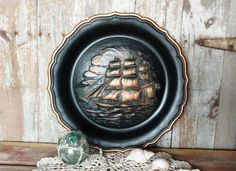 Check out this item in my Etsy shop https://www.etsy.com/listing/503004462/vintage-black-copper-nautical-wall-art
