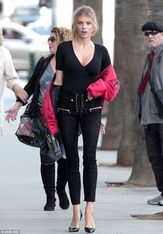 Red hot: The 23-year-old star slung a red bomber jacket around her shoulders for a little ...