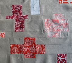 strip quilt - using mainly grey creates a back ground for simple plus sign shapes