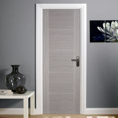 This Vancouver style door in a light grey colour has a particleboard solid core…