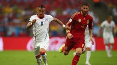 Arturo Vidal of Chile controls the ball against Sergio Ramos of Spain during the 2014 FIFA World Cup Brazil Group B match between Spain and Chile at Maracana on June 18, 2014 in Rio de Janeiro, Brazil. (Photo by Clive R