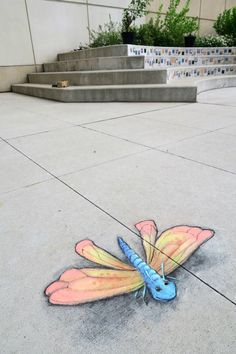 """David Zinn: """"C.S. Mott Children's Hospital. June 11 ·  This guy showed up early, which may explain why his wing/body ratio is so odd. (Also, thanks to a small hole in the concrete, his eye follows you wherever you go.)"""""""