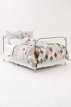 Not only did I get this quilt on massive sale, I grabbed both sets of gorgeous pillow shams for $22 each. I will definitely recreate this bed one day.
