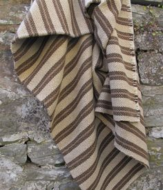 These examples were woven in two strips on a narrow loom and then hand stitched together down the centre     Usually heavier in weight and often woven in soft, earthen colours, characteristic of authentic vegetable dyes, the blankets pre date 1910 and the introduction of the wide loom  Bird's eye weave with cream and fudge brown ground with dark chocolate and fudge brown narrow stripes £385