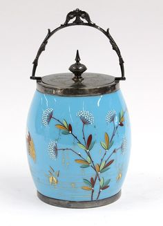 Bristol blue glass aesthetic covered biscuit jar, 19th century, featuring enamel decoration of cranes and flowers with a sunset in the backg...