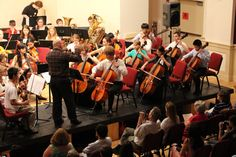 Tim Terranella conducts the cello section during the orchestra performance.