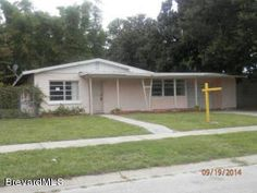 Three bedroom, one bath concrete block home centrally located in Titusville. The carport has been enclosed and the yard is fenced! This is a Fannie Mae HomePath property.