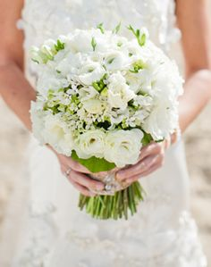 Roses, carnations, and greens create this bouquet