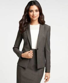 A high neckline is the most appropriate for business professional dress. This is a great, simple suit for a job interview, too!