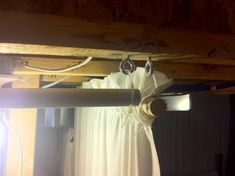Cheap way to cover unfinished basement walls with curtains