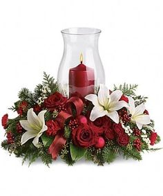 Holiday Glow Centerpiece Flowers - Its beginning to look a lot like Christmas! Add a warm glow to your holiday décor with this lush arrangement of red roses and carnations. Christmas Flower Arrangements, Christmas Table Centerpieces, Christmas Flowers, Christmas Candles, Flower Centerpieces, Xmas Decorations, Christmas Holidays, Christmas Wreaths, Christmas Ornaments