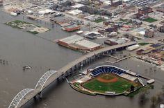 The Quad Cities River Bandits and the Peoria Chiefs play a baseball game April 20 inside Modern Woodmen Park in Davenport, Iowa. The rising flood waters of the Mississippi River surround the stadium which is protected by a flood wall.