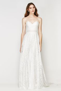 The Victoria from the Willowby Collection by Watters is a classic A-line bridal gown that features a simple strapless sweetheart neckline and a satin ribbon that accents the waistline! The Ruca lace throughout the entire dress is absolutely romantic and the sweep train gracefully slides across the floor as you walk down the aisle!