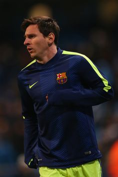 Lionel Messi of Barcelona warms up during the UEFA Champions League Round of 16 match between Manchester City and Barcelona at Etihad Stadium on February 24, 2015 in Manchester, United Kingdom.