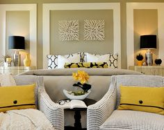 Love the framed out bed and nightstands. Love the mixes of patterns and colors. yellow black and white.