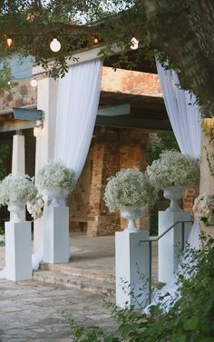 Gypsophila in white urns - baby's breath arrangements - Outdoor Wedding Ceremony Decor