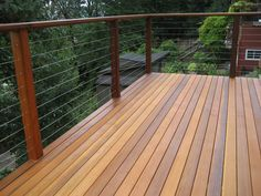 Clear cedar deck with stainless tension wire.