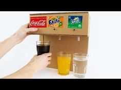How to Make Coca Cola Soda Fountain Machine with 3 Different Drinks at Home. In my case, it's Coca-Cola, Fanta and Sprite but you can use any drink! You need: Cardboard Battery DC mini air pump motor 3 x Push button switch 2 tubes thin and. Vending Machine Diy, Crafts To Do, Easy Crafts, Soda Fountain Machine, Coca Cola, Soda Machines, Diy Cardboard, Drink Dispenser, Candy Dispenser