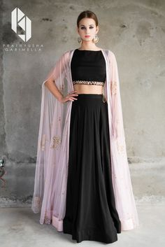Shop Prathyusha Garimella Pink embellished cape jacket with black lehenga set , Exclusive Indian Designer Latest Collections Available at Aza Fashions Lehenga Designs, Indian Wedding Outfits, Indian Outfits, Bridal Outfits, Indian Attire, Indian Wear, Pakistani Dresses, Indian Dresses, Black Lehenga