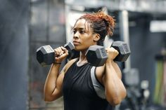 Common Workout Mistakes You're Probably Making (And How To Fix Them) Fit, young African American woman working out with hand weights in a fitness gym.Fit, young African American woman working out with hand weights in a fitness gym. Weight Lifting Workouts, Fat Burning Workout, Weight Training, Muscle Mass, Gain Muscle, Build Muscle, Muscle Building, Muscle Food, Fitness Gym