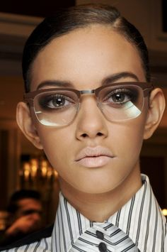 Clear glasses, matte lipstick and makeup