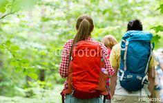 """Laden Sie das lizenzfreie Foto """"close up of friends with backpacks hiking"""" von Syda Productions zum günstigen Preis auf Fotolia.com herunter. Stöbern Sie in unserer Bilddatenbank und finden Sie schnell das perfekte Stockfoto für Ihr Marketing-Projekt!"""