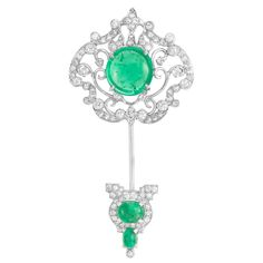 Belle Epoque Platinum, Cabochon Emerald and Diamond Jabot  The openwork jabot composed of a garland and scrolled design, set throughout with 93 old-mine and single-cut diamonds approximately 2.00 cts., topped by one round cabochon emerald approximately 8.00 cts., tipped by 2 oval cabochon emeralds, circa 1910