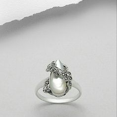 COMING SOON Marcasite & Pearl 925 Silver Ring NWT COMING SOON! MORE PICTURES TO BE POSTED WHEN ITEM ARRIVES. LIKE THIS LISITING TO BE NOTIFIED WHEN THE PRICE DROPS! Beautiful NWT Marcasite and Pearl ring. Size 6. Hallmarked 925 sterling silver. Brand new, never worn. Comes in original packaging. Feel free to ask any questions. PRICED TO SELL! Bundle for further discounts. Boutique  Jewelry Rings