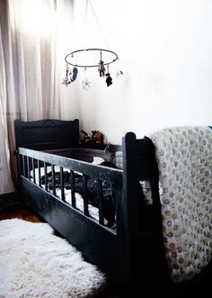 my friends and family teased me when my  babes were small - saying i was the only one they knew that thought there were  not enough black colored clothes or furnishings for kids. :)