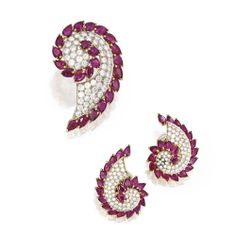 PROPERTY FROM THE COLLECTION OF JEAN VAN WAVEREN 18 Karat Two-Color Gold, Ruby and Diamond Brooch and Earclips, Chantecler, Capri The paisley-shaped brooch and earclips set with pear-shaped rubies weighing a total of approximately 34.50 carats, accented by numerous round diamonds weighing approximately 9.00 carats, the brooch and one earclip signed Chantecler Capri on applied plaques