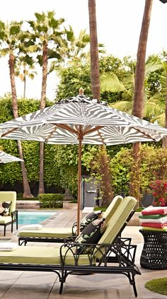 Take cover from the sun and relax under the exotic canopy of our Scalamandre Zebra Skin Onyx Umbrella. Revered for its incomparable quality, taste and style, Scalamandre has fashioned the fabric exclusively for Frontgate's outdoor collection. | Frontgate: Live Beautifully Outdoors