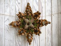 Pine Cone Tree Topper.. would be pretty just to hang or pretty to use as an outdoor tree topper..