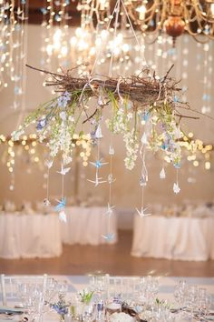 The decor of our thousand crane winter wedding reception was absolutely gorgeous! I couldn't have asked for anything more perfect. It really was a winter wonderland, with hanging branches, fairy lights, leaves, flowers and paper cranes. See it all: http://www.confettidaydreams.com/thousand-crane-winter-wedding/ Thousand Crane Winter Wedding - Alexandra Graham Photography
