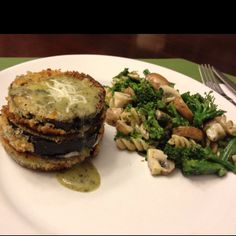 Jessica's Kitchen: Breaded Eggplant stacked with Mozzarella Cheese in between an drizzled with a creamy pesto sauce... steamed broccoli & mushrooms w/ whole grain pasta and the same sauce :-) Sliced Eggplant about 1in thick, dipped in egg and dredged in panko bread crumbs, pan fried in coconut oil... layered provolone between the slices when served. Sauce is Knorr Creamy Pesto Sauce.