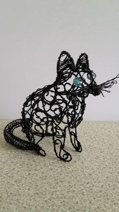 Wirework Black cat with Apatite eyes and spinel nose.