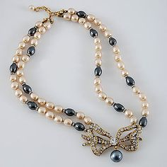 Authentic CHANEL Double Faux Pearls Necklace with Beautiful Rhinestone Bow