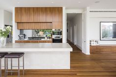 Top 5 Inexpensive kitchen Room ideas Guthrie House Concrete benchtop timber veneer joinery smoked glass splashback that reflects the garden from outside. Kitchen Design, Kitchen Decor, Kitchen Confidential, Splashback, Joinery, Cleaning Hacks, Family Room, Sweet Home, Guthrie House