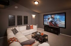 Dark walls make the screen the true focus of any media room. We love how this white leather sectional provides plenty of seating. Santa Rita Ranch North // Liberty Hill // Highland Homes // Plan 245 room design Home Theater Room Design, Home Cinema Room, Home Theater Rooms, Den Room, Media Room Seating, Small Media Rooms, Creative Kids Rooms, Small Lounge, Media Room Design